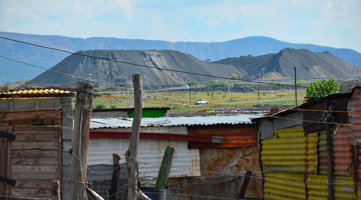 A platinum mine in northern South Africa seen from a nearby informal settlement