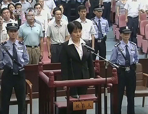 Gu Kailai, the wife of disgraced politician Bo Xilai, listens to the verdict during her trial