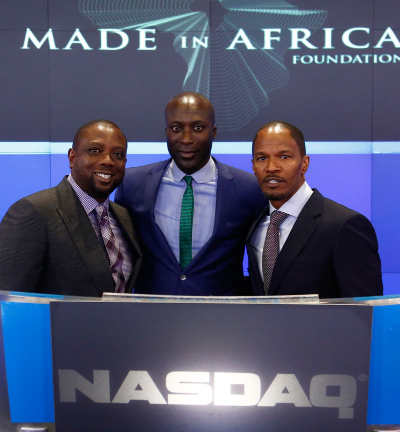 From left, Kola Aluko, with fashion designer Ozawald Boateng and Oscar-winning actor Jamie Foxx at a charity event