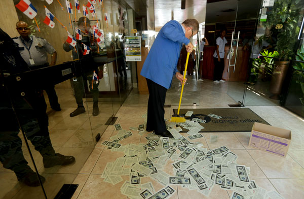 Protesters threw fake dollar bills while police raided Mossack Fonseca's headquarters in Panama City in April