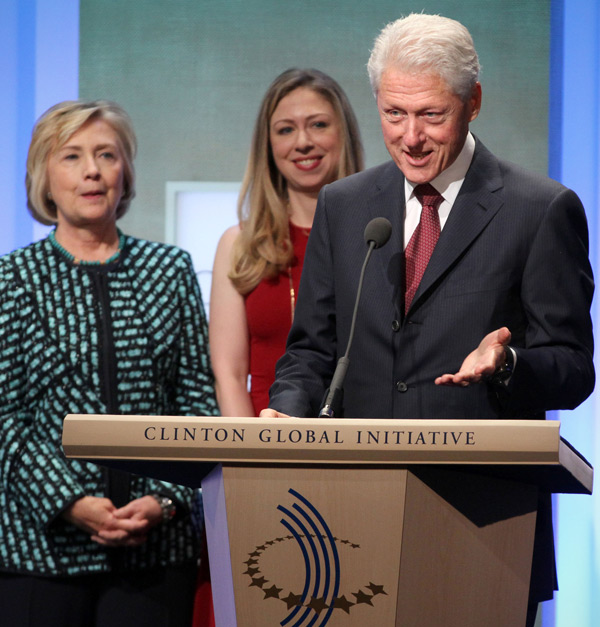 Bill Clinton speaking at a Clinton Foundation event with wife Hillary and daughter Chelsea