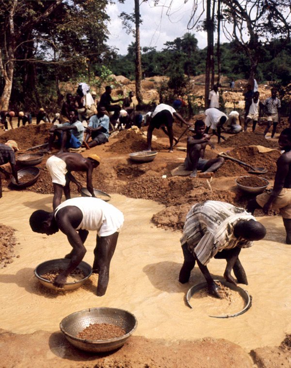Sifting for diamonds in a river in Congo