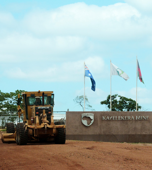The Australian flag flies over an entrance to Paladin's Kayelekera mine in Malawi