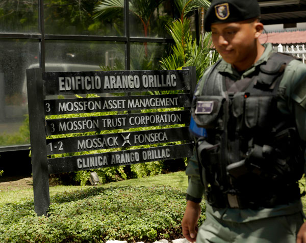 A police officer outside Mossack Fonseca's Panama City office