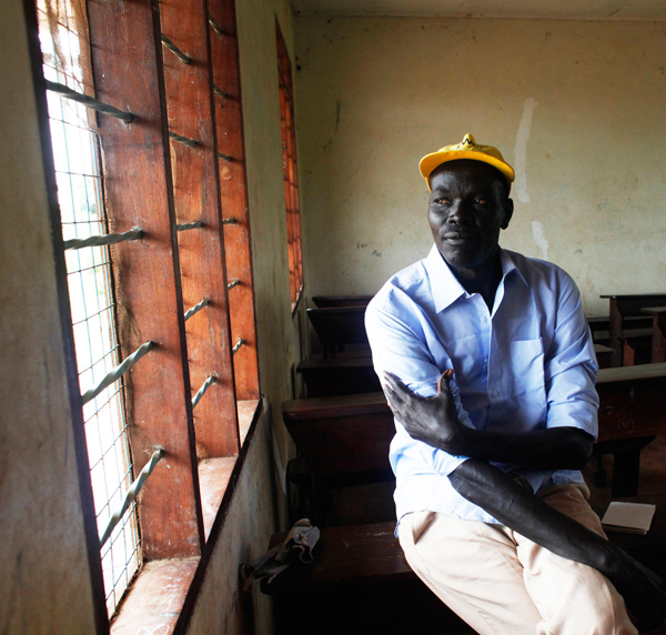 Othow Nyigwo, a former education official in Gambella, sitting in a school classroom in the Gorom Refugee Camp
