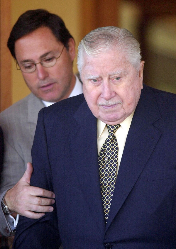 Former Chilean dictator Augusto Pinochet, right, with his son Marco Antonio