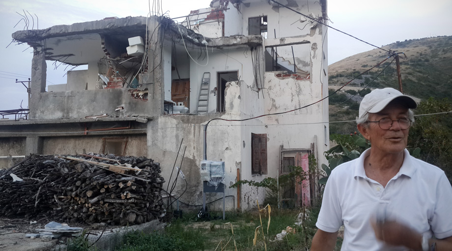 Andon Koka's home in Jale was flattened, and half of his brother's home (in background) was demolished