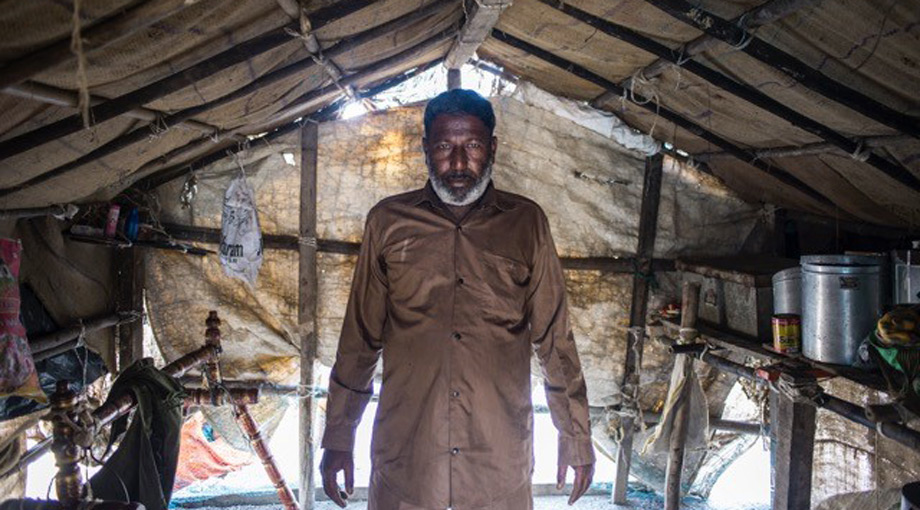 Yunus Suleman Gadh stands in the hut that serves as his home for eight months a year