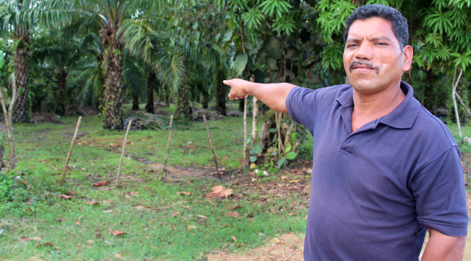 Francisco Ramirez, a local farmer, points to the escape route where he says he fled after being shot in the face during an attempted takeover of Dinant Corporation's El Tumbador plantation