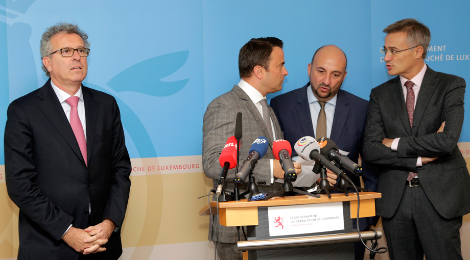From left, Luxembourg's Finance Minister Pierre Gramegna, Prime Minister Xavier Bettel, Economy Minister Etienne Schneider and Justice Minister Felix Braz speak with each other prior to a media conference