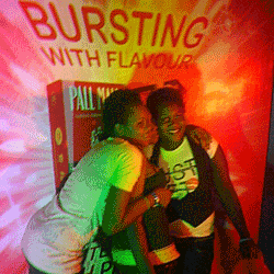 Young women pose at an invitation-only smoking party in Lagos, Nigeria